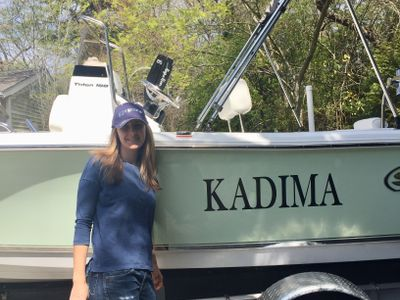 "Me with our family boat, ""Kadima"""